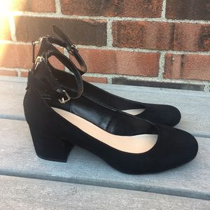 Black heeled strapped shoes